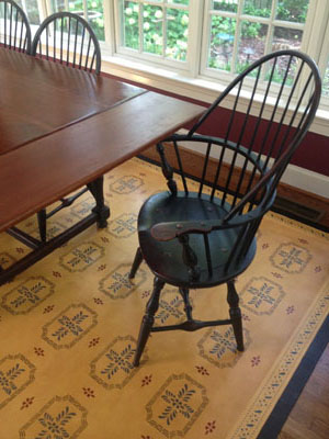 Close up picture of Bump Tavern Floorcloth in Dining room setting.